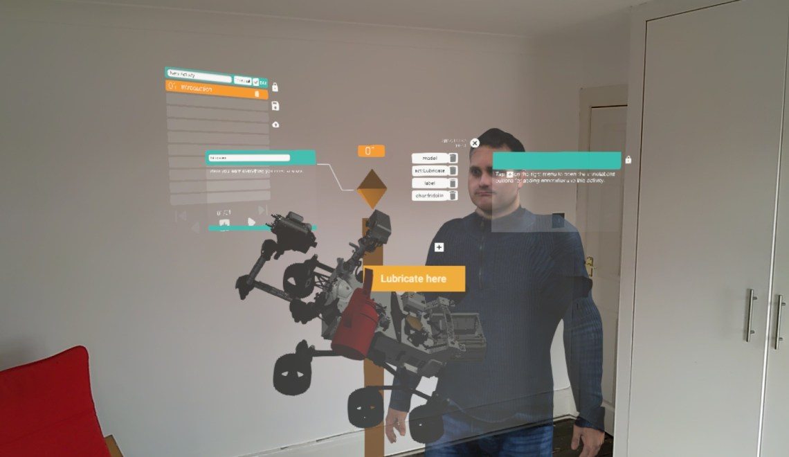 Mixed Reality capture of the authoring tool: Mars Rover, 3D character model, several lists.