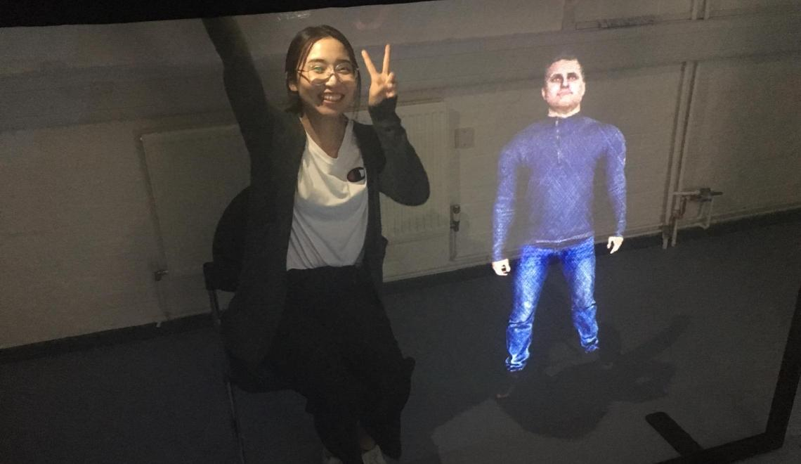 Interacting with a projection holographic AI.